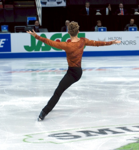 Adam Rippon performing a spread eagle