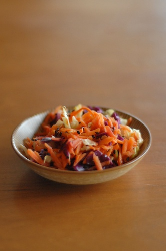 Asian style slaw in a very small bowl