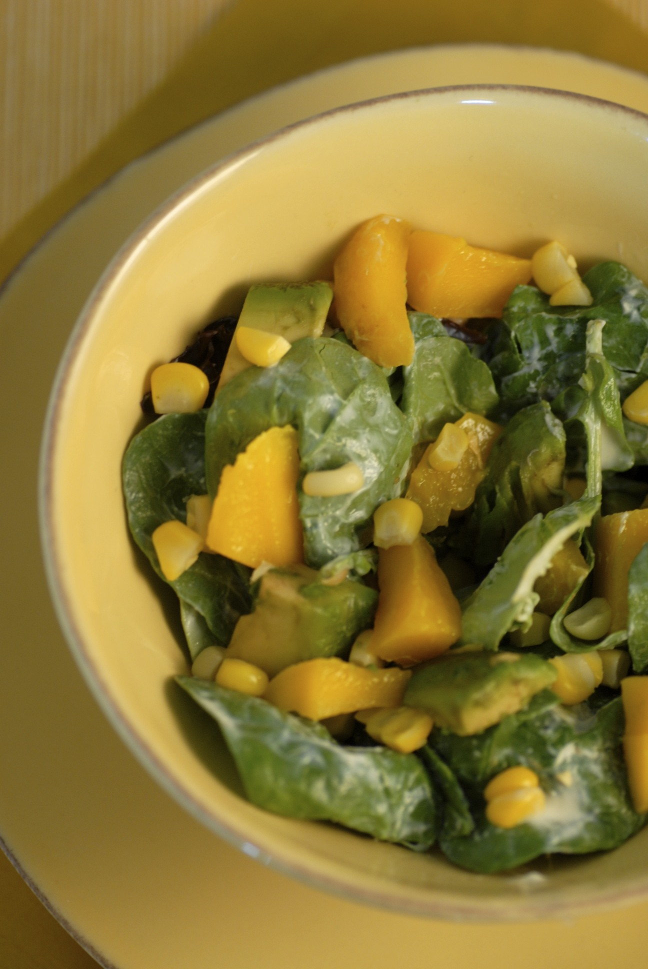 salad with avocado, roasted corn, mango, and creamy ginger dressing