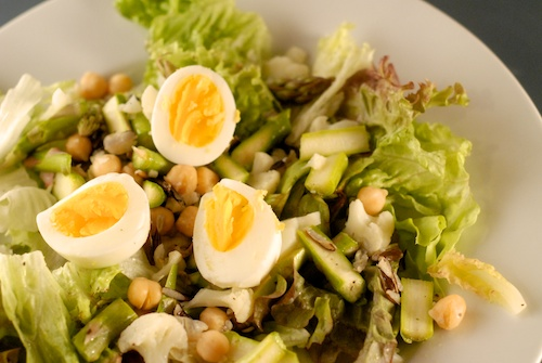 salad with lettuce, chickpea, wild rice, asparagus, cauliflower, and hard-boiled egg slices