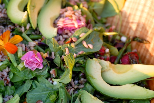 Mother's Day Picnic Salad with asparagus, edible flowers, sunflower seeds, pepitas, mixed greens, avocadoes