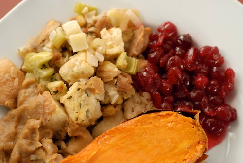 Christmas dinner with baked yam, cranberry sauce, and chestnut stuffing