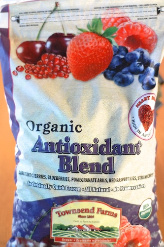 bag of Townsend Farms Organic Antioxidant Blend with illustration of cherries, pomegranates, strawberry, raspberries, and blueberries