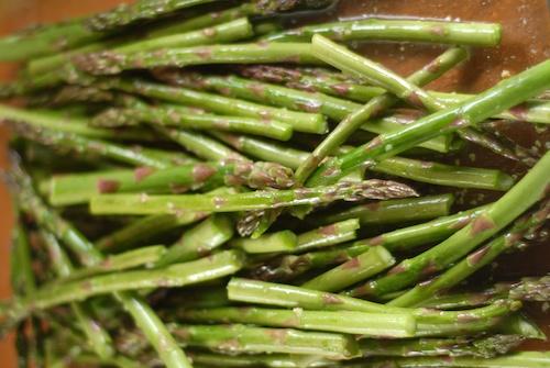 asparagus shown in a glass dish