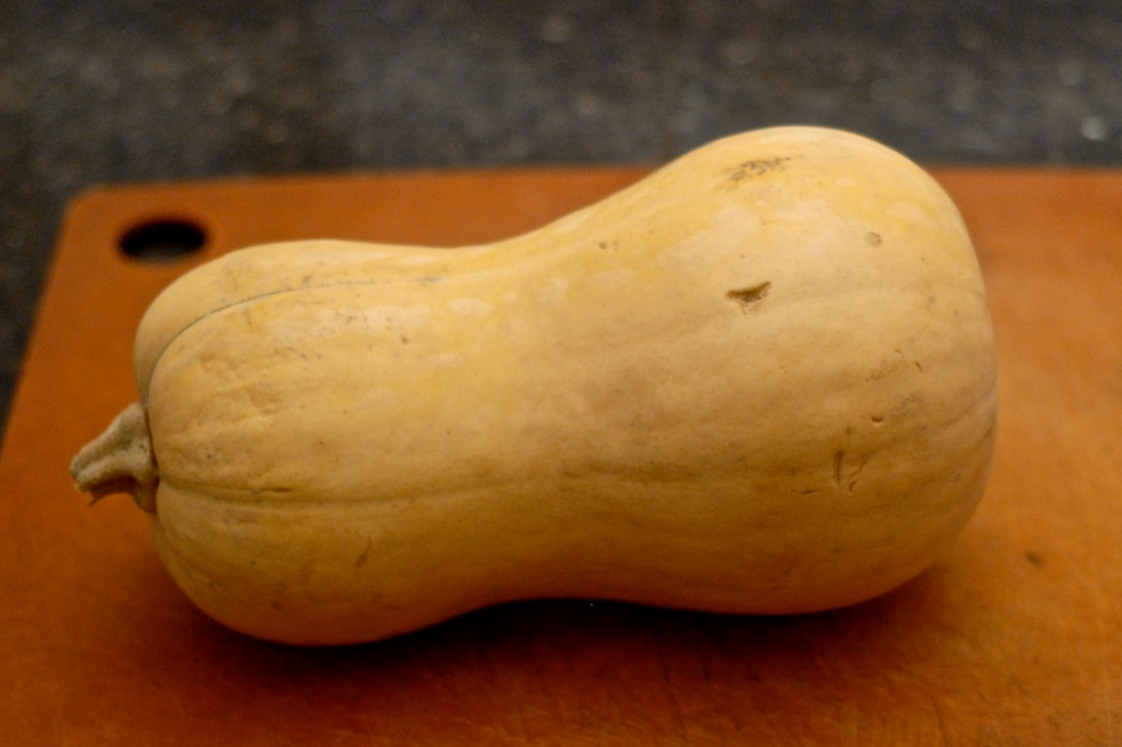 whole butternut squash shown on a cutting board