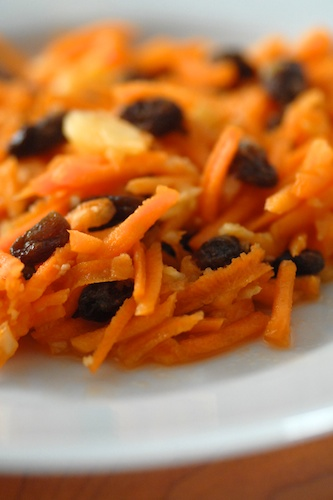 close-up of prepared carrot, raisin and pineapple salad on a plate
