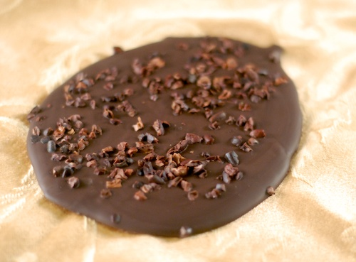 a slab of chocolate bark with cocoa nibs