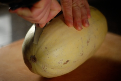 cutting the other end of the spaghetti squash with Shun chopping knife