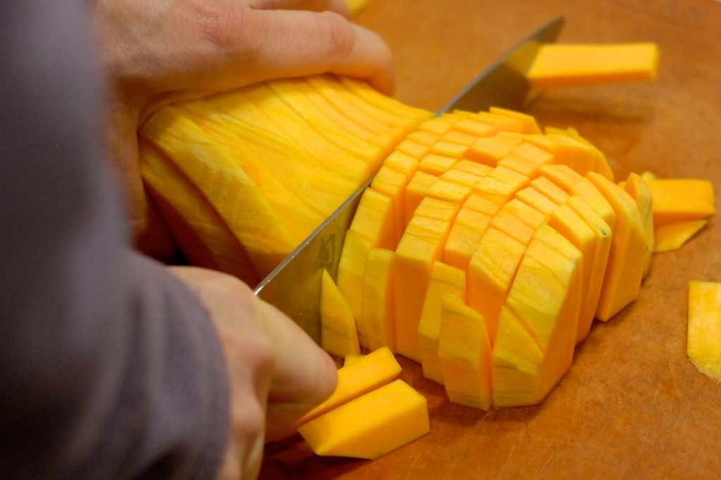 cutting butternut squash into rounds with a chef's knife