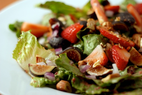 fig, strawberry and toasted hazelnut salad dressed with fig viniagrette