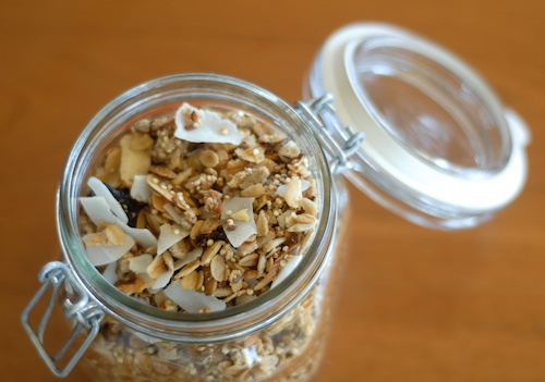 granola with almond, raisin, and pepita shown in open jar