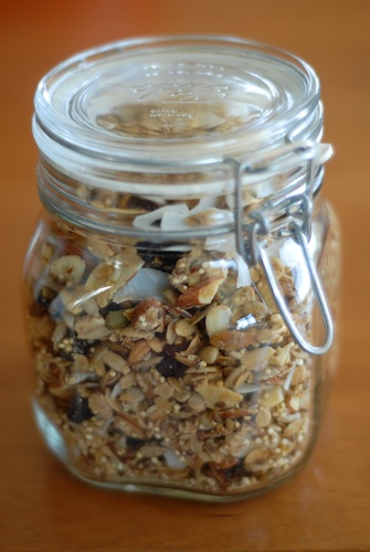 granola with almond, dried cherries, and pepitas in a canning jar