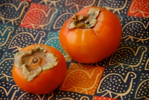 two hachiya persimmons on placemat