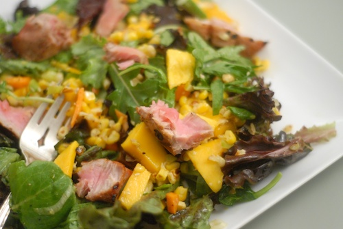 salad with baby greens, mango, roasted corn, and ahi tuna