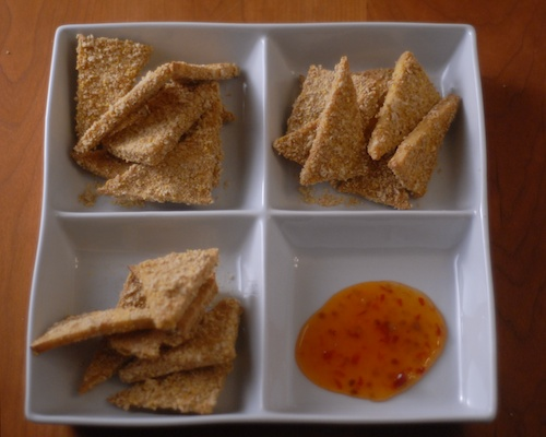 panko breaded tofu triangles in divided serving dish
