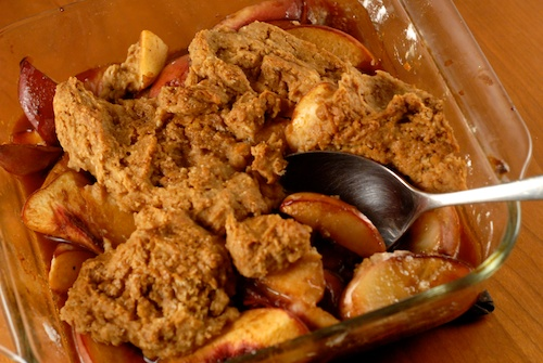 peach cobbler in serving dish