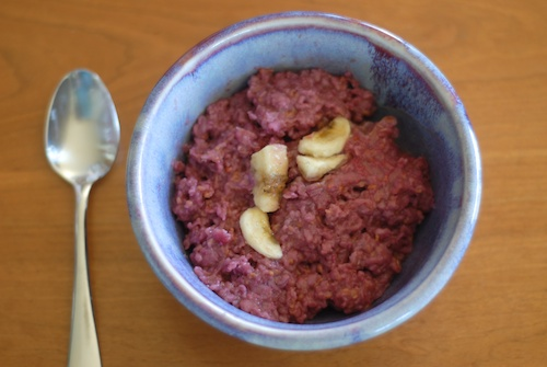 raspberry oatmeal in a purple bowl