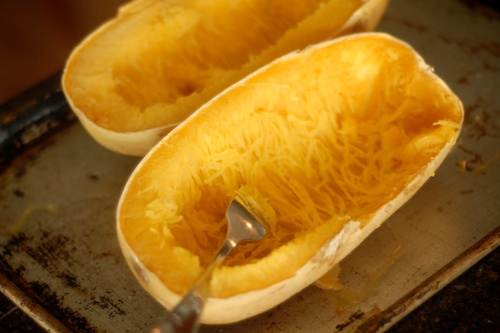 cooked spaghetti squash on a baking sheet