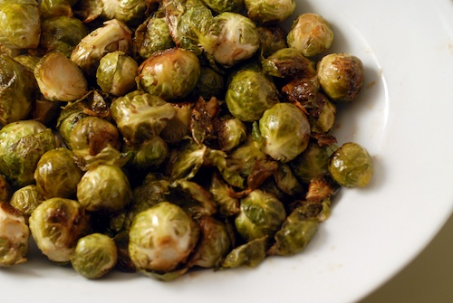 roasted Brussels sprouts in a white serving dish