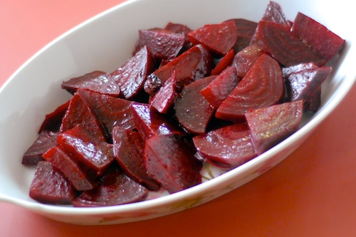 roasted beets in white serving dish