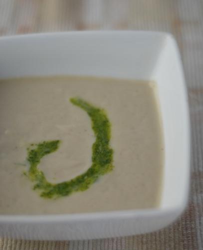 roasted cauliflower soup with a swirl of arugula pesto