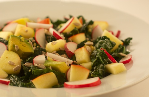 kale salad with honey-ginger-lemon dressing, radishes, apples, and avocado