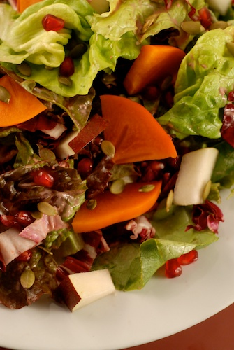 salad with pomegranate, Fuyu persimmon, and pomegranate dressing