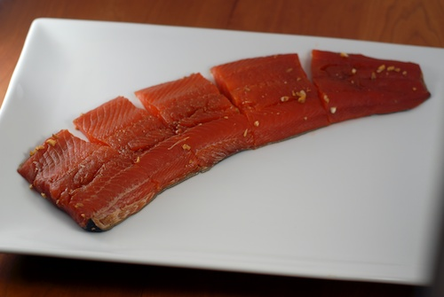 salmon shown cut into individual fillet portions, on a plate