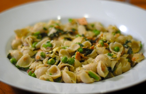pasta with peas, basil, and smoked salmon, on a dinner plate
