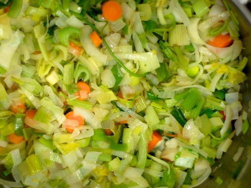 sauteed vegetables shown in a large stockpot