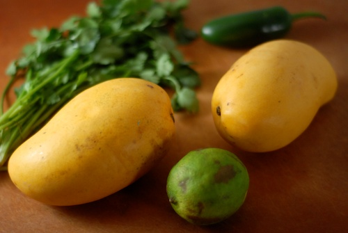 ataulfo mangoes shown with lime jalapeno and coriander