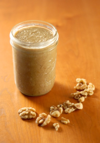 jar of freshly made walnut butter with walnuts